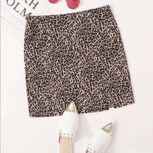 Leopard print skirt with a split hem